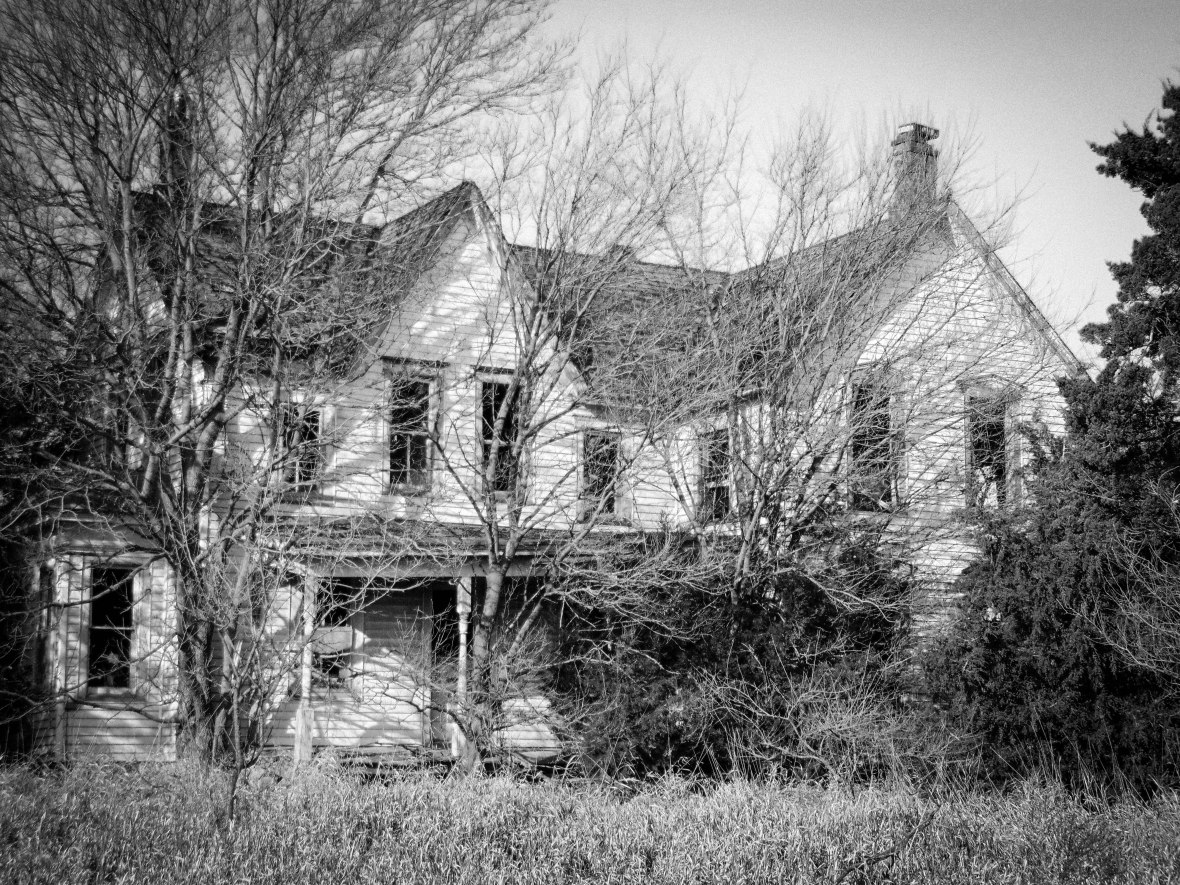 A Magnificent Splintered White Farmhouse And Creaking Barns Loom Out At The Vast Kansas Prairie Shadows Of Years Past Watch From Numerous Gaping